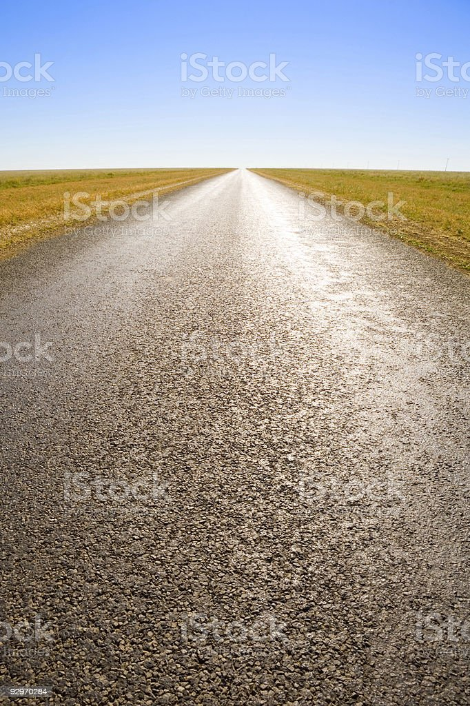 Long Straight Road in Outback Australia with Dramatic Light royalty-free stock photo