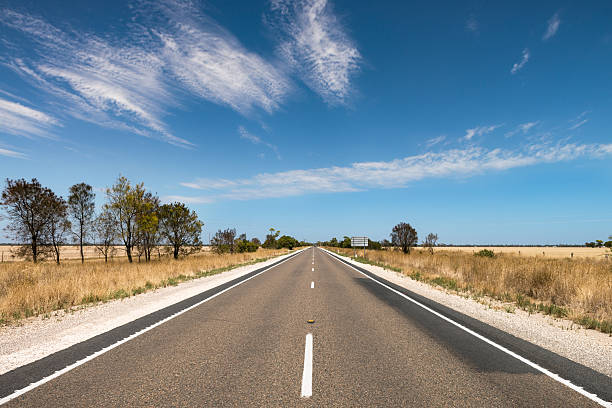 Long, straight road through outback in South Australia stock photo