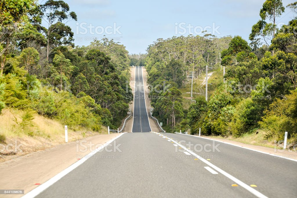 long straight uphill road from the perspective of the driver stock photo