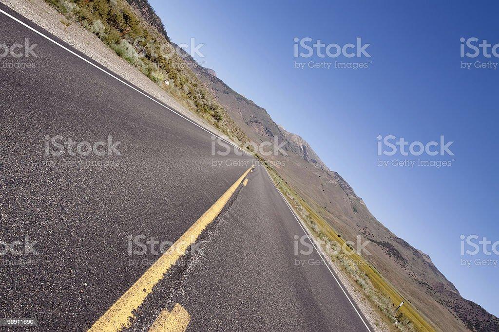 Long stretch of asphalt road royalty-free stock photo