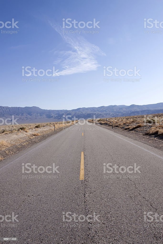 Long stretch of desert road royalty-free stock photo