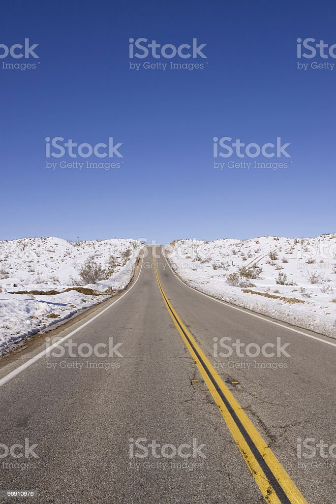 Long stretch of road royalty-free stock photo
