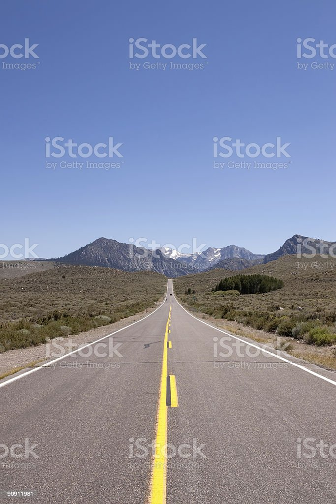 Long stretch of road to Sierra Nevadas royalty-free stock photo