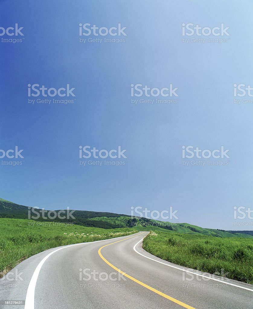 Long stretch of road winding into the distance royalty-free stock photo