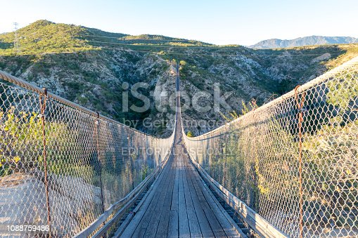 This is the very long suspension bridge in Wild Canyon in Los Cabos, Mexico.  This bridge stretches across a long canyon and is used for both foot traffic and ATV traffice.
