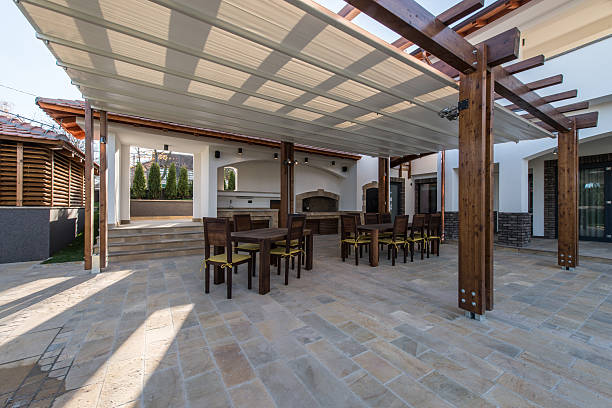 Long table and chairs on veranda in luxury villa exterior stock photo