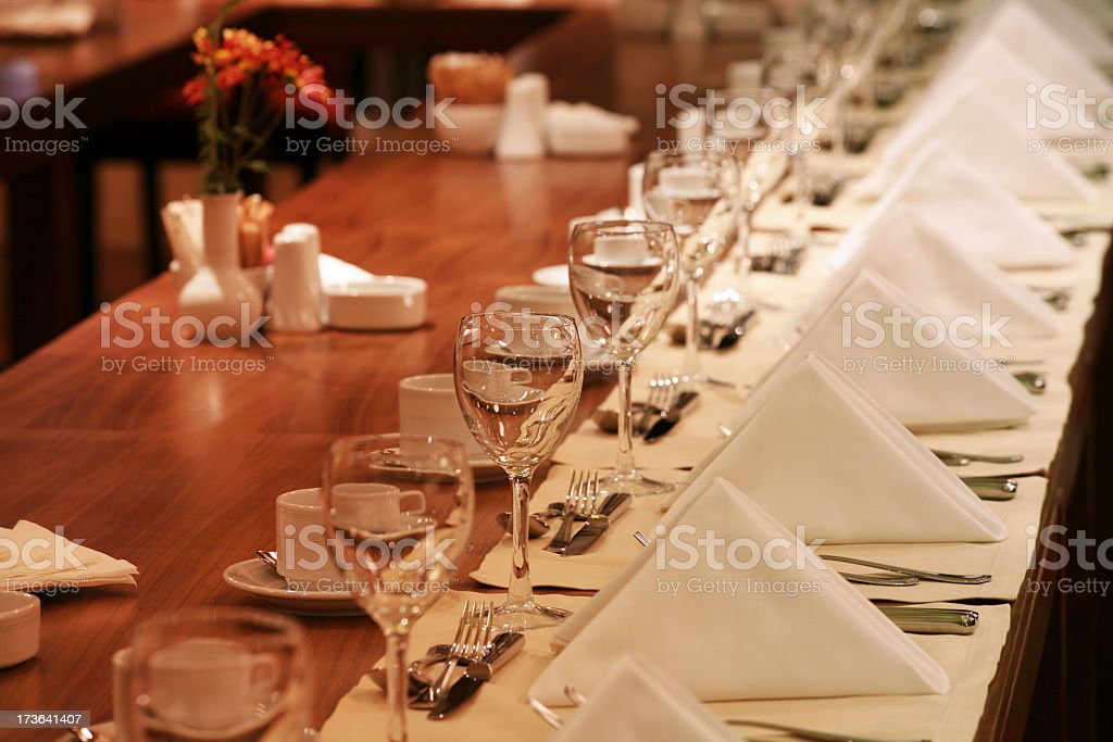 A long table presented in a restaurant stock photo