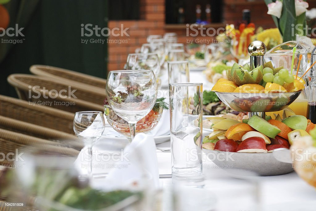 A long table with table settings and food in a restaurant royalty-free stock photo