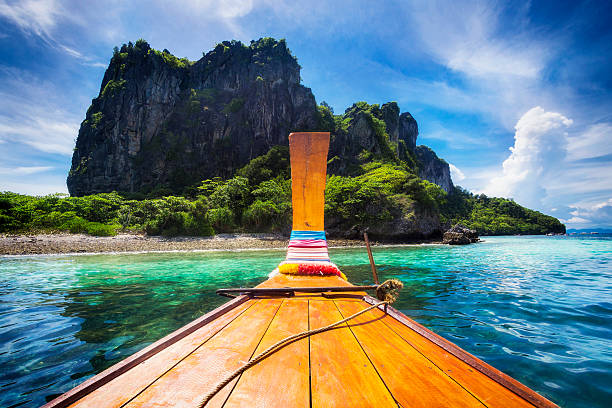 long tail boat in maya bay, koh phi phi, thailand - travel destinations stock photos and pictures