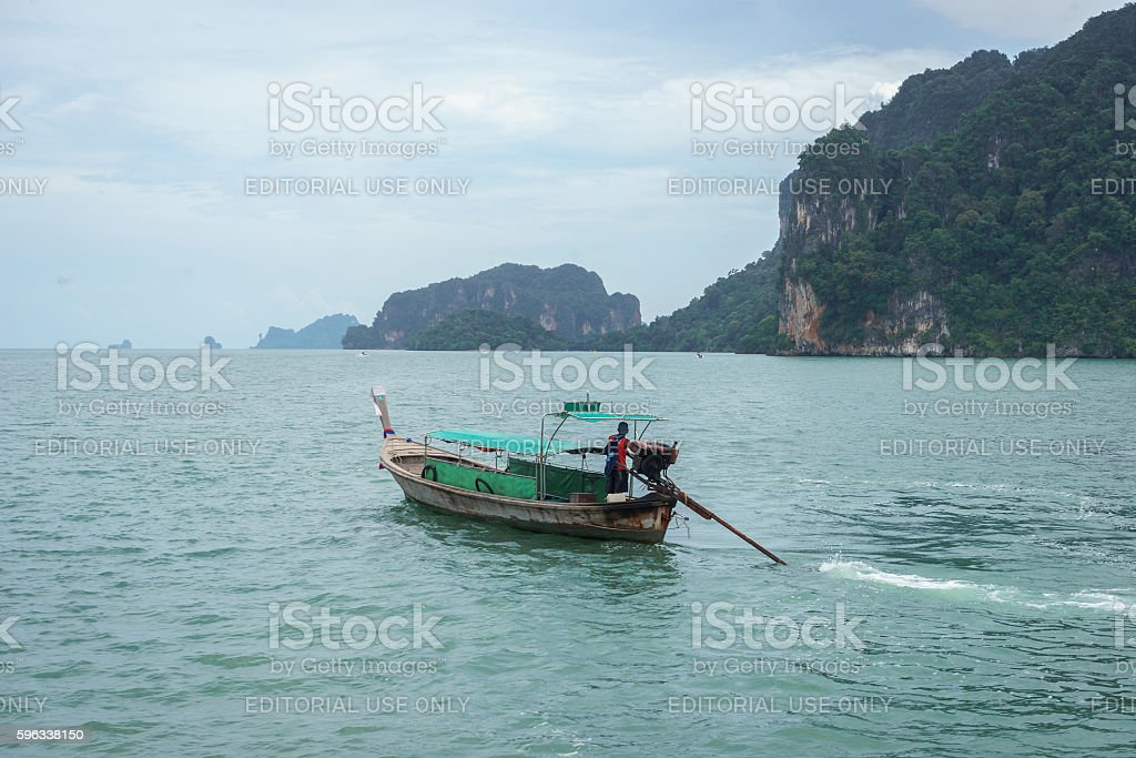 Long tail boat in sea with mountain and sky background royalty-free stock photo