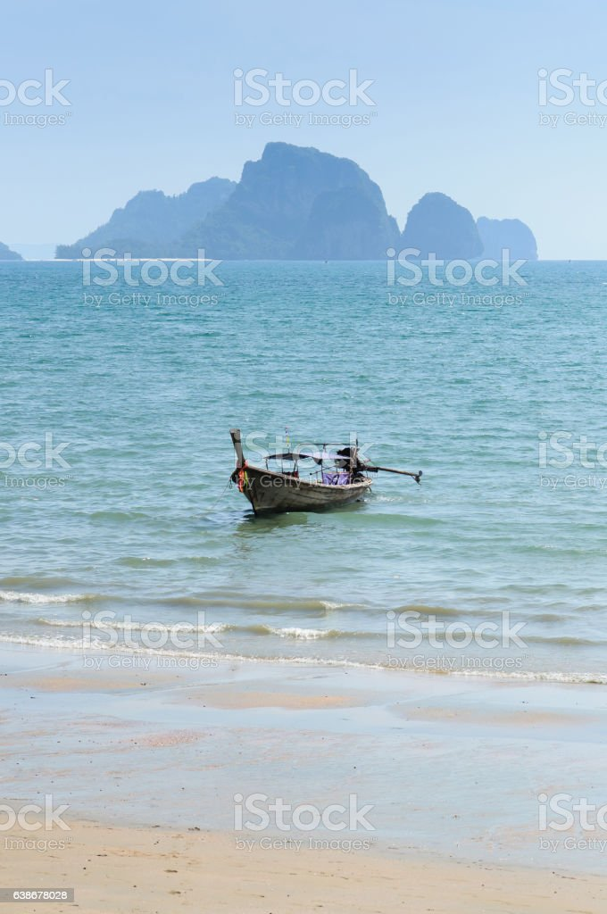 Long Tail boat on the beach in Krabi Thailand stock photo