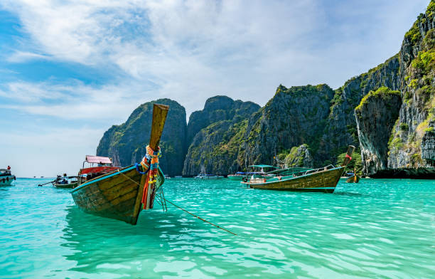 long tail boat on the beach - phuket stock photos and pictures
