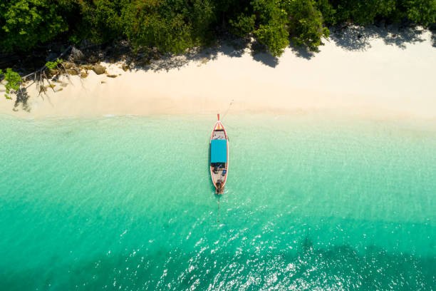 long tail boat on the beach.wonderful background.aerial view from andaman beach. - phuket stock photos and pictures