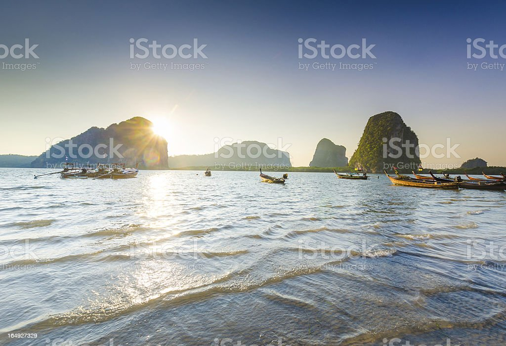 Long Tail boat sits in the beautiful beach royalty-free stock photo