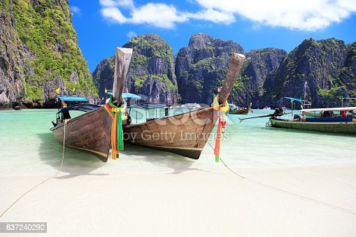 istock Long tail wooden boats 637240292