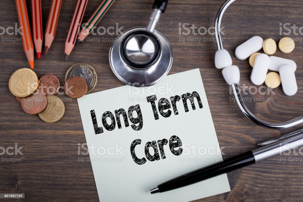 long term care concept. Desk with stetascope, money and tablets. background for medical care stock photo