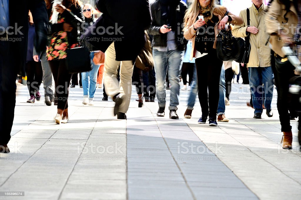 Long time exposure of pedestrians royalty-free stock photo