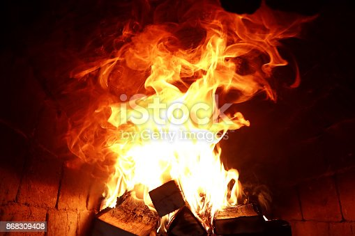 874991150istockphoto Long tongues of flame of burning fire 868309408