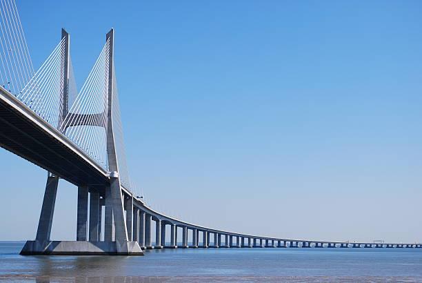 Long Vasco da Gama Bridge over water in Lisbon, Portugal stock photo