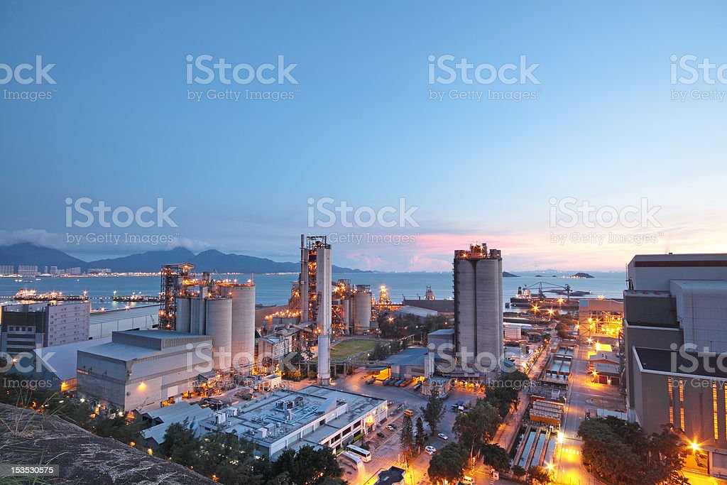 Long view of concrete plant at dusk or dawn stock photo