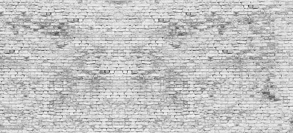 Long white brick wall stock photo