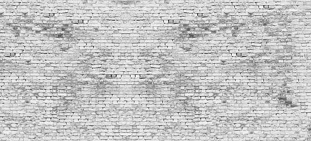 Long white brick wall stock photo