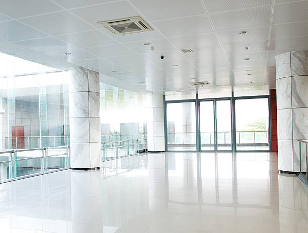 Long white empty corridor with large glass panels stock photo
