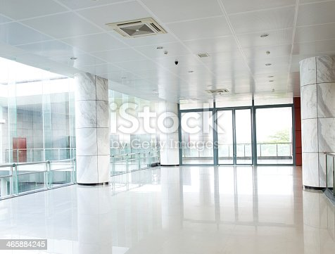 Long White Empty Corridor With Large Glass Panels Stock