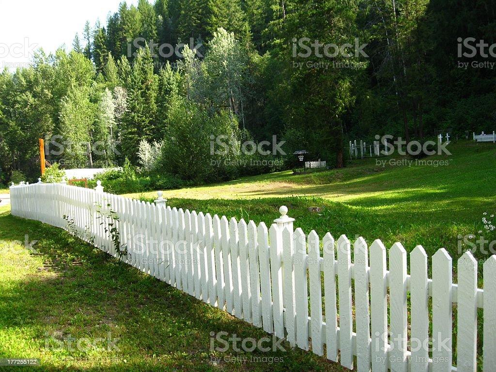 Long white fence stock photo