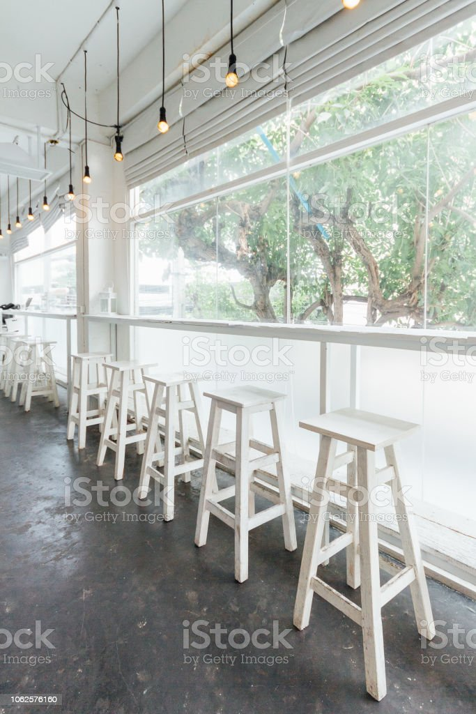 Picture of: Long White Wooden Table And Chairs With Glass Window And Trees In Background Stock Photo Download Image Now Istock