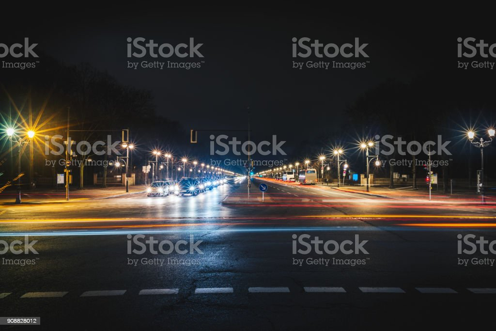 Long wide city road at night stock photo