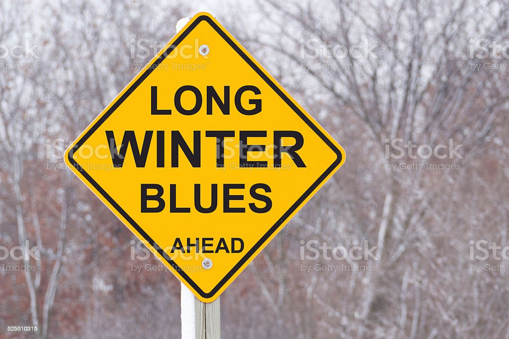 Long Winter Blues Ahead Road Sign stock photo