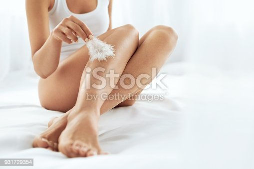 931733062 istock photo Long Woman Legs With Beautiful Skin. Beauty Body Care Concept 931729354