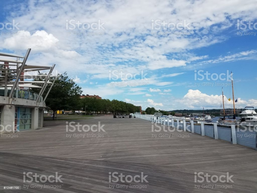 long wood boardwalk in navy yard in Washington, DC stock photo
