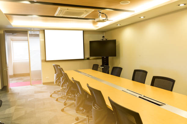 long wooden table in meeting room white board and video conference sunlight from door long wooden table in meeting room white board and video conference sunlight from door overhead projector stock pictures, royalty-free photos & images