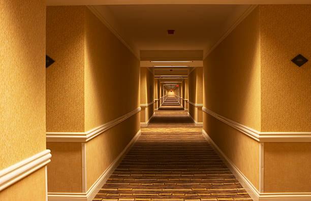 Long Yellow corridor in a hotel stock photo