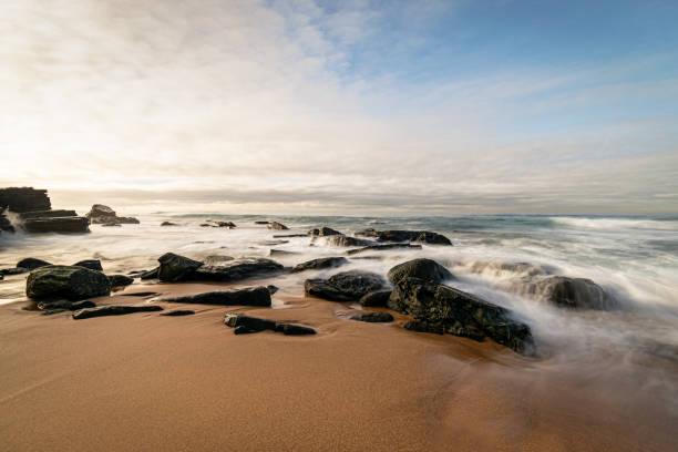 Long_exposure_rocks_beach_colours_1 stock photo