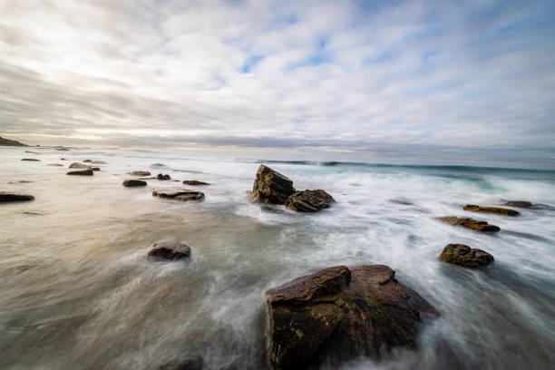 Long_exposure_rocks_beach_colours_3 stock photo