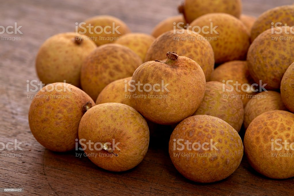 Longan fruit on a wooden background. stock photo