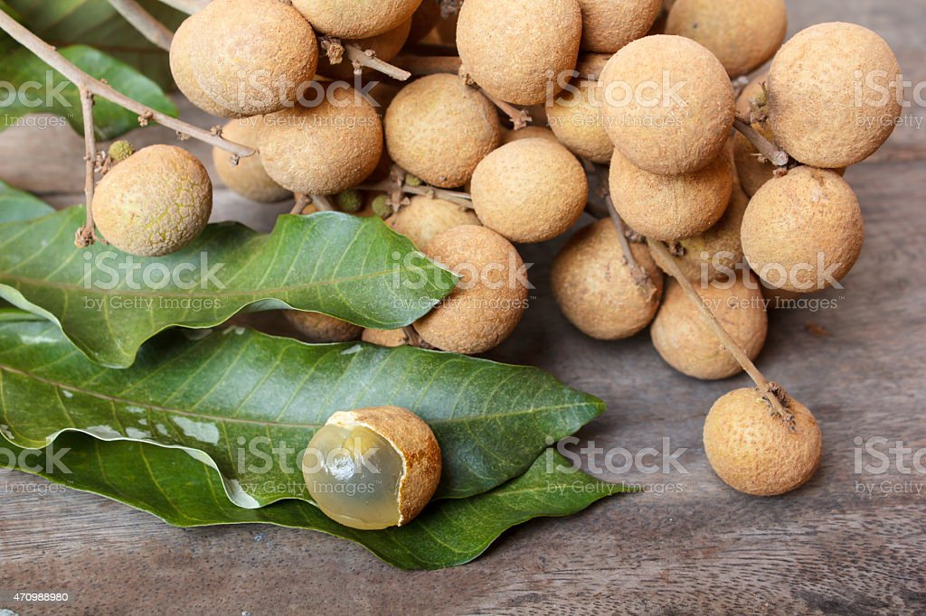 Longan on old wooden table. stock photo