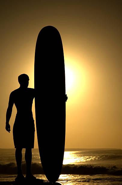 Longboard bei Sonnenuntergang 1 – Foto