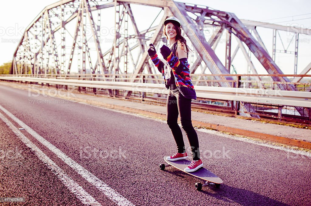 longboard girl on the street royalty-free stock photo