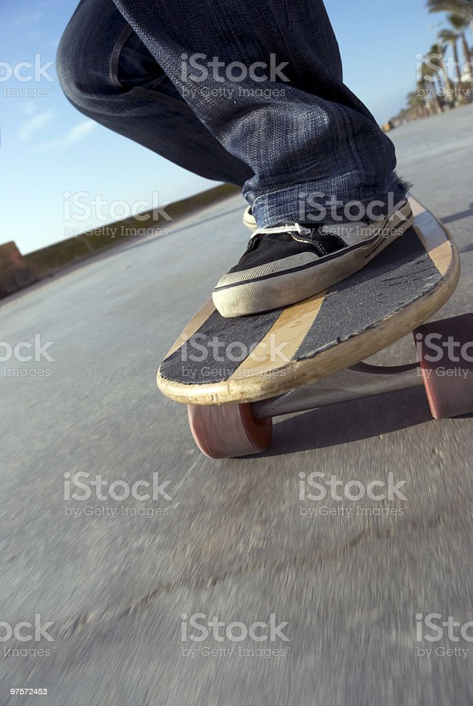 Longboard skating at the seafront royalty-free stock photo