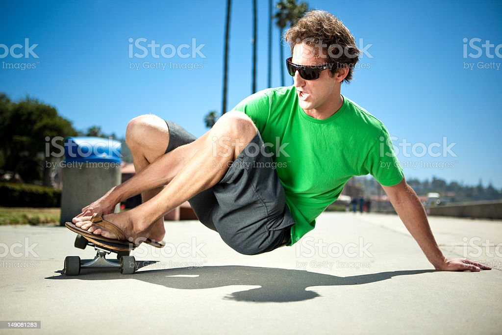 Longboard slide stock photo