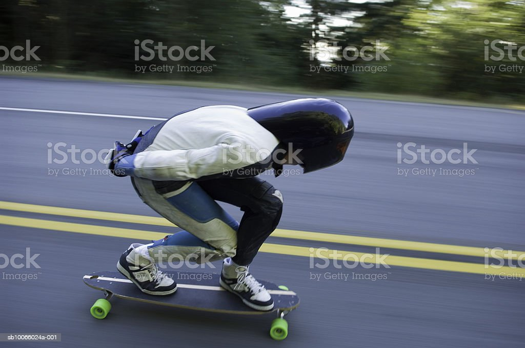 Longboarder on road, side view royalty-free stock photo