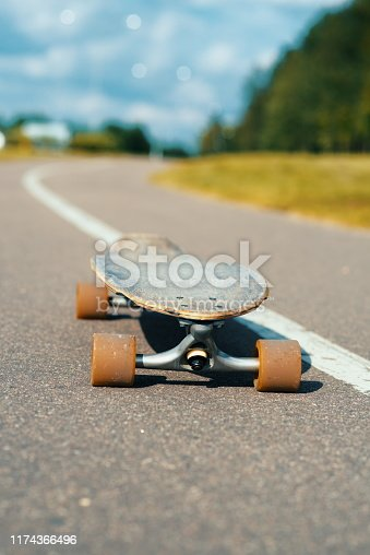 Longboards by the asphalt road at the border