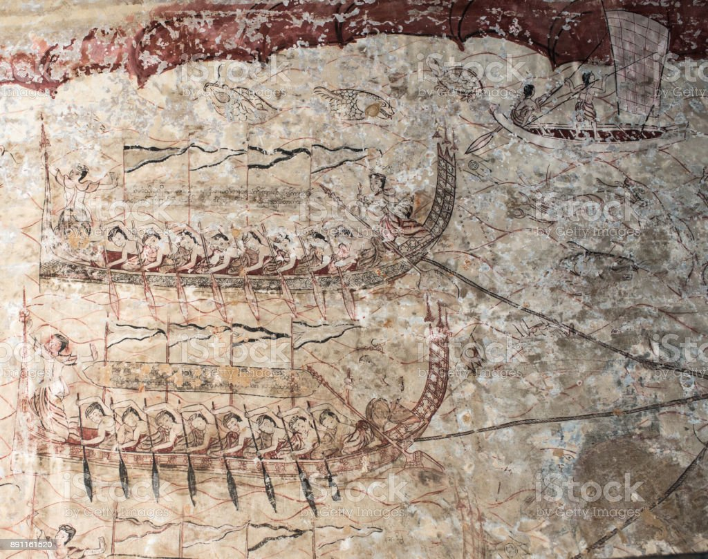 Longboat painting in an ancient Burmese mural inside the Sulamani Temple stock photo