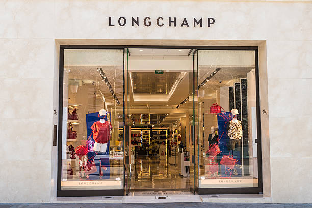 Longchamp shop, Barcelona Barcelona, Spain - March 27, 2015: Longchamp shop located on Passeig de Gracia, one of the most expensive streets in Europe. gracia baur stock pictures, royalty-free photos & images