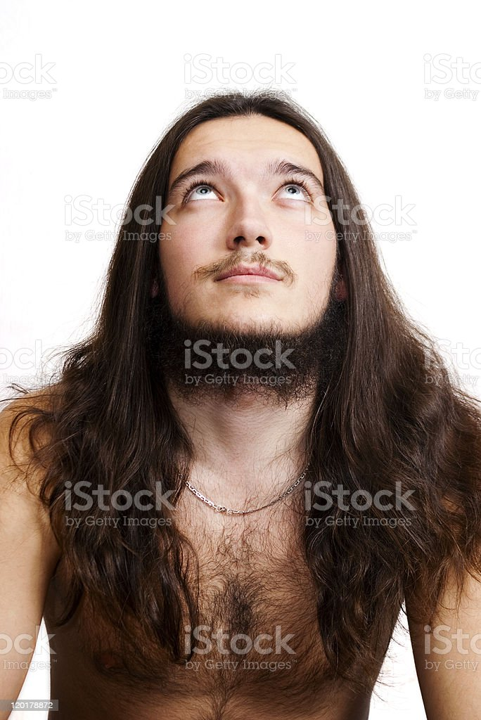 Long-haired bearded man looking up. stock photo