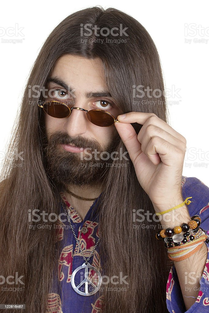 Long-haired hippie man with the glasses royalty-free stock photo